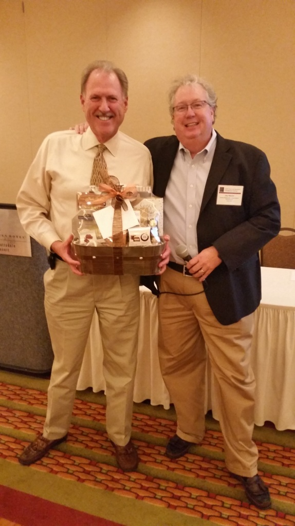CSAA Executive Director Jay Hauhn, right, presents a thank you gift to Safeguard's Mark Demler.